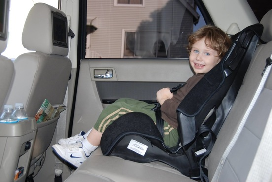 Kid in a limo with booster seat